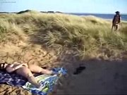 Horny slut loves to be watched while she masturbates at beach Thumbnail