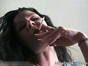 hot brunette slut smokes cigarette