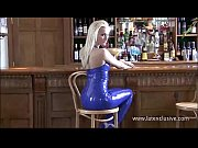 Beautiful blonde latex fetish babe Natashas shiny outfit on night out in a bar