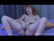 redhead mature drills her pussy with.