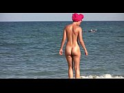 sexy nudist babes tanning naked at the beach.
