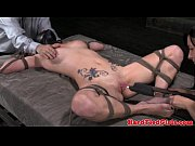 Leather head bondage sub frogtied to bed