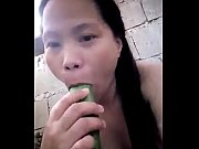 Asian masturbating with cucumber
