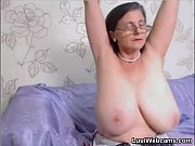 granny plays with her pussy on.