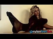 Blonde secretary in stockings swings feet under your nose