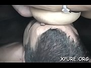 large gal sitting on guy'_s face