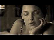 Katherine Heigl shows feet on bed sepia