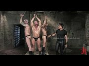 Three bound gay victims wait for their punishment in an underground facility Thumbnail