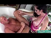 Big titted brunette MILF fucking her lover with a massive strap-on