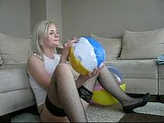 Sophie in miniskirt, stockings and red bra playing with beachball