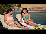 Gorgeous lesbians make love in pool