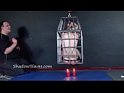 caged blonde female slaves whipping and hanging bondage.