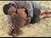 Big King Kong Negro Kissing Slim Lady on the Beach