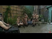 Public plaza with undressed men prepared for wild rough violent gay group sex Thumbnail