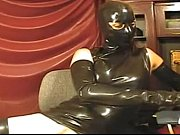 girl in latex tight dress and mask on.