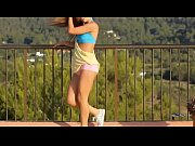 Hot chick dancing on sun deck