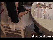 Cute teen Kitty reading a magazine