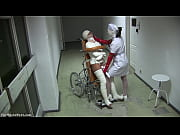 patient in wheelchair with broken legs and straitjacket.