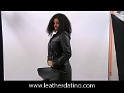 Ebony beauty posing in leather jacket, skirt, top and high boots