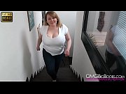 busty blonde running on the stairs