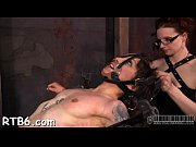 fastened up slave receives tight mask with hard.