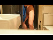 Horny brunette masturbating in the bathroom