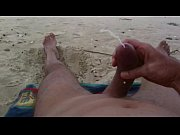 Curved cock wank and cum at nude beach
