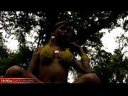 Feminine shemale in yellow bikini showcases her round boobs Thumbnail