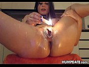 kinky babe applies hot candle wax on her.