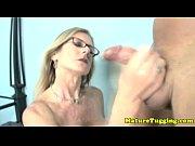 Blonde spex milf jerking his hard cock