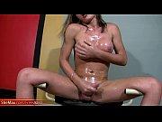 feminine shemale beauty strokes her oiled.