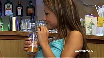 Two young lesbian whores in a bar touching each other