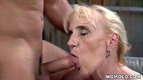 Muscular guy fucks a mature woman
