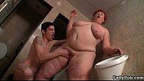 Huge fatty is slammed in the public restroom