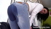 Dirty slut pisses her denim jeans