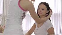 Two cute bi-curious teen girls tenderly kiss an...