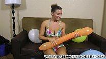Busty teen pops balloons in bikini