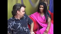 Young Indian lady gives an older man a blow job on a red couch - download porn videos