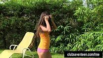 Tanned teen Vivien masturbating outdoors