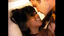 A pretty black shemale welcomes his lover at home Thumbnail