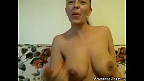 Busty milf shows her tits and smokes a cigarette Thumbnail