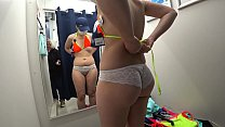 Mature milf and her young daughter in a public fitting room. Different swimsuits and mini bikinis on sexy big ass. thumbnail