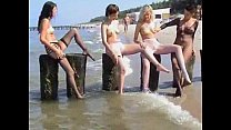 young innocent brunette plays outside at the beach Thumbnail