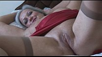 Attractive bust granny in slip and stockings st...