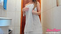 Coming out of the towel-only bath dancing and p...