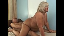 Blonde fatty lies on bed and let her man brush ...