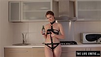 Skinny redhead covers herself in oil and mastur...