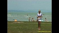 Crazy pee girl on the beach
