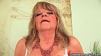 Grandmother with large breasts pushes huge dild...