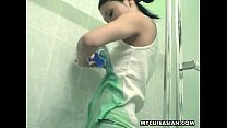 Pouring soda all over herself in the shower